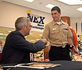US Navy 090305-N-9689V-002 Taylor Hicks visits with Sailors and other visitors during an album signing at the Navy Exchange onboard Naval Air Station, North Island.jpg