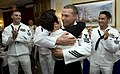 US Navy 090521-N-1722M-111 Naval Aircrewman 1st Class William J. Frost, assigned to Helicopter Sea Combat Squadron (HSC) 85, hugs his wife after being selected as the 2009 Reserve Sailor of the Year.jpg