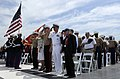 US Navy 090522-N-3595W-022 Military active and retired service members salute the colors during a wreath laying ceremony aboard the Intrepid Museum as part of Fleet Week New York 2009.jpg
