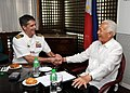 US Navy 090811-N-9565D-041 Capt. David A. Lausman, commanding officer of the aircraft carrier USS George Washington (CVN 73), greets the Mayor of Manila, Alfredo S. Lim during an office call.jpg