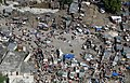 US Navy 100120-M-8752R-003 Earthquake victims use tents, tarps and other materials for shelter in Leogane, Haiti.jpg