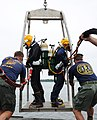US Navy 100712-N-9769P-494 Navy Divers are lowered from the Military Sealift Command fleet ocean tug USNS Apache (T-ATF 172).jpg
