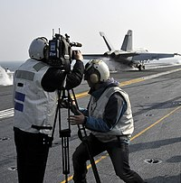 US Navy 101129-N-7103C-162 Reporters from Korean news media capture footage of an F-A-18E Super Hornet assigned to the Eagles of Strike Fighter Squ.jpg