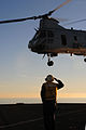 US Navy 101213-N-3659B-056 Boatswain's Mate 1st Class Adam Cohen, from Bradley Beach, N.J., salutes the aircrew of a CH-46E Sea Knight helicopter.jpg