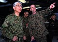 US Navy 110331-N-8607R-110 Col. Andrew MacMannis discusses humanitarian assistance operations with Lt. Gen. Eiji Kimizuka aboard USS Essex (LHD 2).jpg