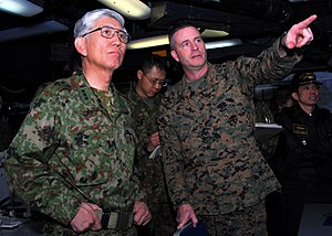 Japan Ground Self-Defense Force - JGSDF Chief of Staff Eiji Kimizuka, speaks with a U.S. Marine officer aboard the USS ''Essex'' (LHD-2), in March 2011.