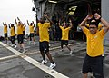 US Navy 110613-N-KB052-101 Sailors conduct physical fitness training on the flight deck of the Ticonderoga-class guided-missile cruiser USS Cowpens.jpg