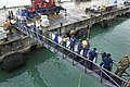 US Navy 111223-N-KS651-081 Sailors, Marines and local nationals bring supplies up the brow of the dock landing ship USS Pearl Harbor (LSD 52).jpg