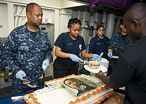 US Navy 120123-N-FI736-180 Sailors serve cake during a Dr. Martin Luther King, Jr. birthday celebration aboard the aircraft carrier USS Enterprise.jpg