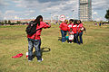 Unite Here - Photographer and group in red t shirts by Washington Monument - 50th Anniversary of the March on Washington for Jobs and Freedom.jpg