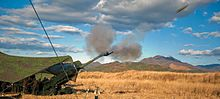 Marines fire an M777A2 155 mm howitzer