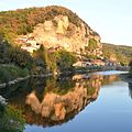 View Eastwards at La Roque-Cageac along the Dordogneriver, with nice rocqu reflections in the eveningsun - panoramio.jpg