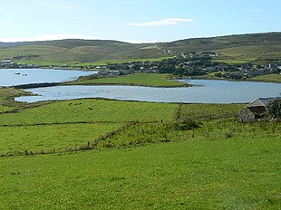 A view of Finstown from across The Ouse, a tidal inlet