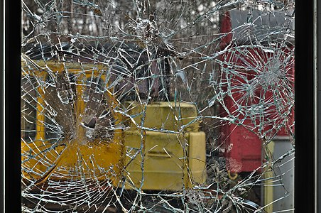 Shattered window of a train door