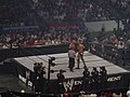 WWE (199) Rock and Goldberg stare each other down.jpg