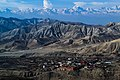 Walled City of Lo Manthang with Layers of barren hills and mountains.jpg