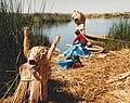 Washing dishes on a reed island in Lake Titicaca in Peru.jpg