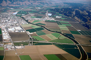 Pajaro River - Aerial view of the Pajaro River at Watsonville, California. The river empties into the Pacific Ocean about 2.5 miles (4 km) west of this photograph. View is to the east.