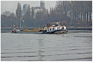 Stokes wave - Waves in the Kelvin wake pattern generated by a ship on the Maas–Waalkanaal in The Netherlands. The transverse waves in this Kelvin wake pattern are nearly plane Stokes waves.