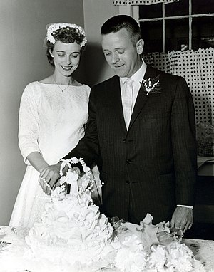 Wedded couple with wedding cake