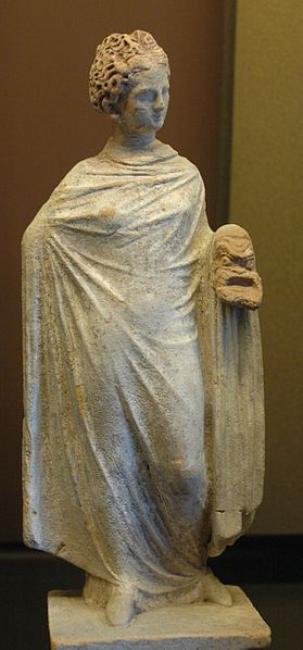Terracotta figurine of a woman holding a theatre mask, from Tanagra