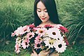 Woman with a bouquet in the meadow (Unsplash).jpg