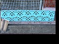 Yarn Bomb - park bench seat (5521430824).jpg