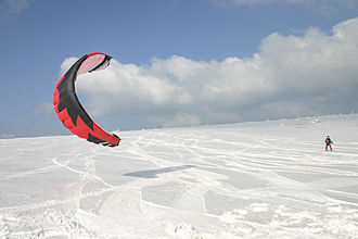 Wind-powered vehicle - Snow kiters travel over snow or ice.