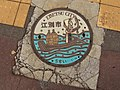 """Traditional lamprey fishing"" Manhole cover of Ebestu city, Hokkaido, Japan. Colored version.jpg"