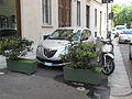 """ 12 - ITALY - Milan Lancia Ypsilon Mk2 grey hatchback green flower.JPG"