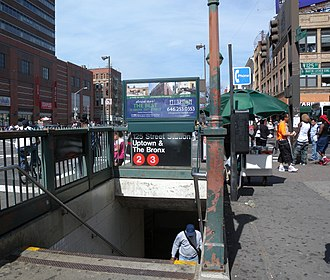 125th Street (IRT Lenox Avenue Line) - Northbound staircase on the southeast corner