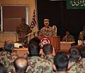 1st Brigade commander addresses crowd of ISAF service members DVIDS404428.jpg