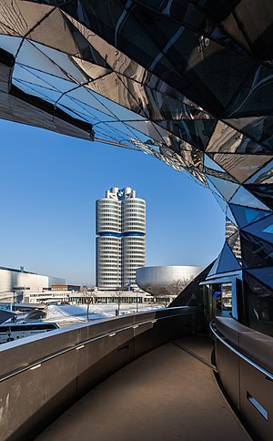 "BMW Tower (""4 Cylinders"") framed by the BMW Welt, Munich, Germany"