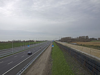 A4 motorway (Netherlands) - A4 south of Delft on 20 December 2015. Right (northbound) lanes are already opened for traffic; left (southbound) lanes are still closed and are expected to be opened later in the day.