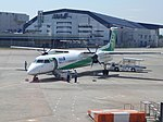 ANA Q400 Green at ITM (15938857399).jpg