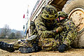 A Czech soldier provides first aid to a fellow soldier during attack training at the 7th Army Joint Multinational Training Command's Hohenfels Training Area in Hohenfels, Germany, Nov. 15, 2013, during exercise 131115-A-BS310-101.jpg