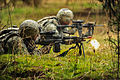 A U.S. Soldier, foreground, assigned to Alpha Company, 1st Battalion, 503rd Infantry Regiment, 173rd Airborne Brigade Combat Team provides suppressive fire with an M249 light machine gun during movement to 140318-A-BS310-055.jpg