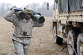 A U.S. Soldier assigned to Bulldog Battery, Fires Squadron, 2nd Cavalry Regiment unloads ammunition for a fire mission with an M777A2 towed 155 mm howitzer during the regiment's mission rehearsal exercise at 130312-A-HE359-047.jpg