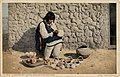 A Woman of Pueblo of Isleta Decorating Pottery, Fred Harvey (NBY 22858).jpg