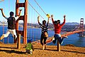 A family photograph of people jumping in Marin County, California, USA with the Golden Gate Bridge in the background.jpg