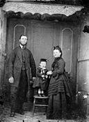 A man, woman and a child NLW3364935.jpg