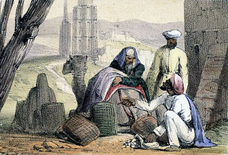 Shell money - A print from 1845 shows cowry shells being used as money by an Arab trader