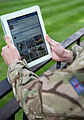 A serviceman accesses social media channels using an iPad, outside MOD Main Building in London MOD 45156047.jpg