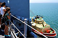 A young girl watches a tugboat as it pulls alongside the amphibious dock landing ship USS Rushmore (LSD 47) while the Rushmore departs for a friends and family day cruise off the coast of San Diego, Calif 120808-N-YQ852-050.jpg