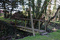 Abbess Roding bridge over roadside stream for public footpath from south - Essex England.jpg