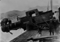 Accident showing steam engine hanging half over the edge of Lyttelton wharf, having been dropped from a crane while being loaded or unloaded ATLIB 305937.png