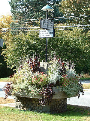 Massachusetts Route 27 - Antique road signs in a well in Acton