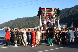 Ainan, Ehime - Men carry a mikoshi during the fall festival