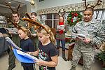 Airmen, school children serenade residents 141209-Z-AL508-030.jpg