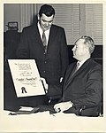 American Airlines presents an award to Mayor John F. Collins (12932082433).jpg
